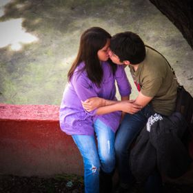 Two young lovers smooching under a tree in Mexico City.