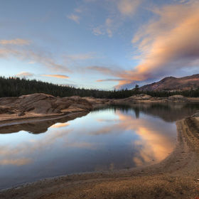 A sunset reflection on a small pond remaining in the drought-stricken Lower Blue Lake, California.