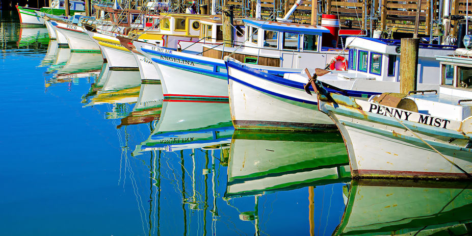 These colorful boats just gleamed on a gorgeous Sunday afternoon in San Francisco\'s Fisherman\'s w...