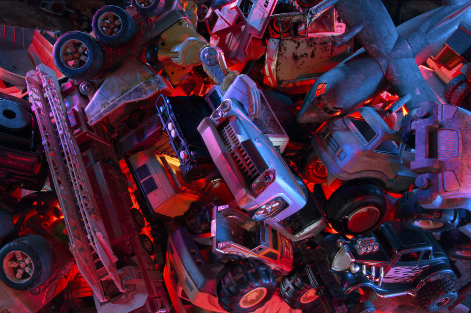 An innocent pile of old toy cars and trucks takes on a quality of a biblical catastrophe under th...