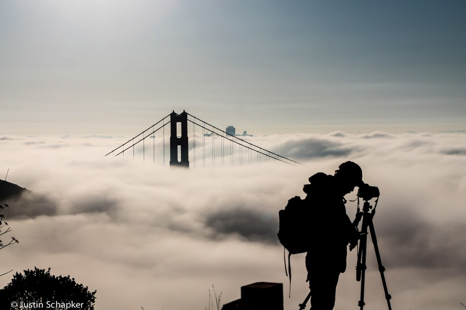 Photographer shooting San Francisco with the morning fog.