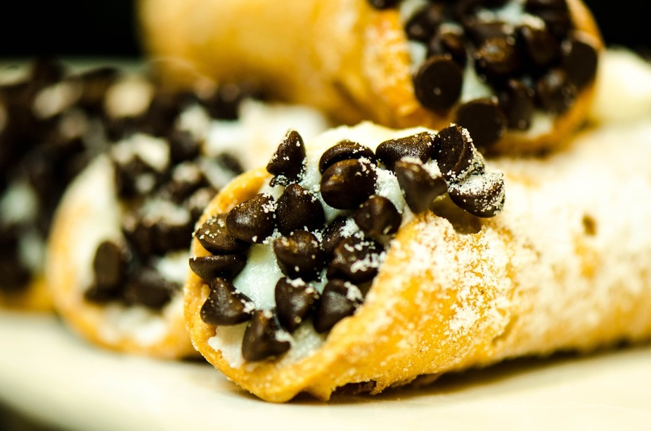 Delicious cannolis with chocolate chips macro shot