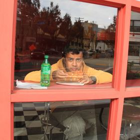 Saw this boy eating his favourite pizza sitting inside and enjoying the out side view photo ws  taken in Bethesda Maryland the scene outside and ...