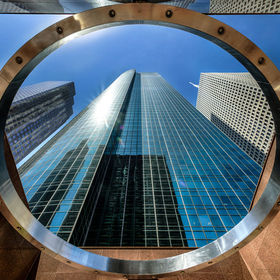 The large ring marks the entrance to the Wells Fargo Plaza which was completed in 1983 as the First Interstate Bank Plaza. Its neighbors, Enterpr...