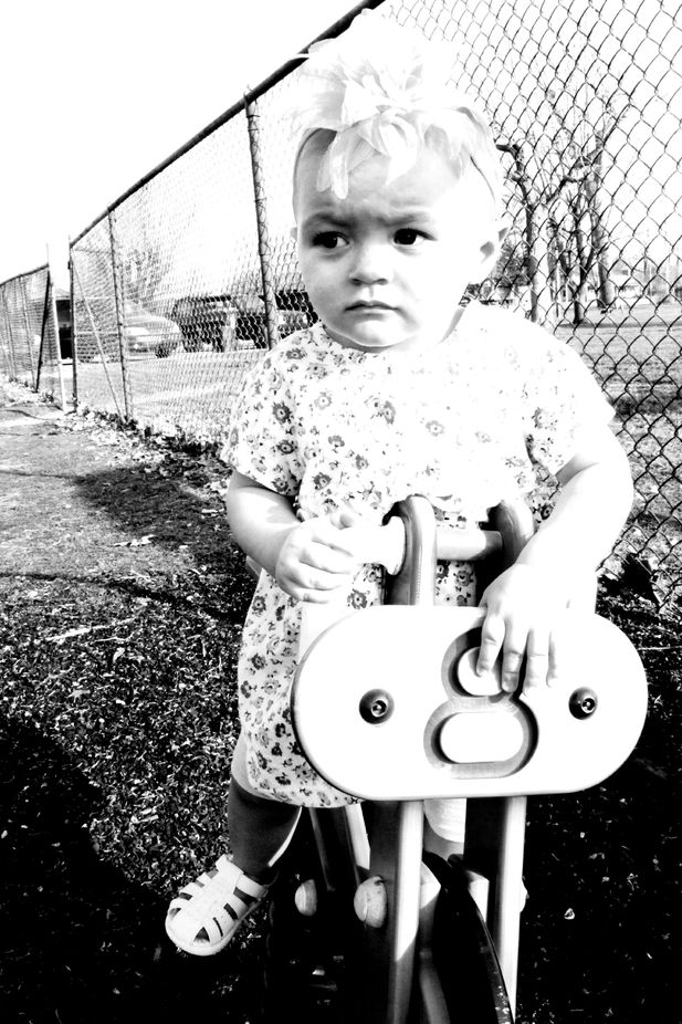 B&W Old time look. Baby\'s first outing one playground toys.