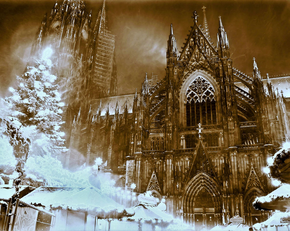 A long-exposure of blowing snow outside the Cologne Cathedral. The Christmas tree on the left is ...
