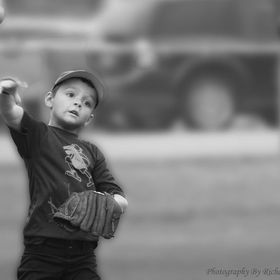 A photo that is near and dear to my heart, enthralled by this game of catch, a son enjoys time spent with his father. A small task that could mea...