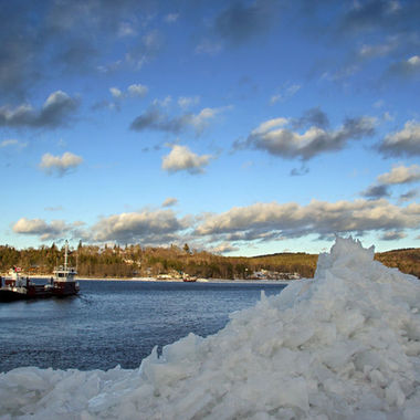 A cable ferry crossing the Saint John River in winter.