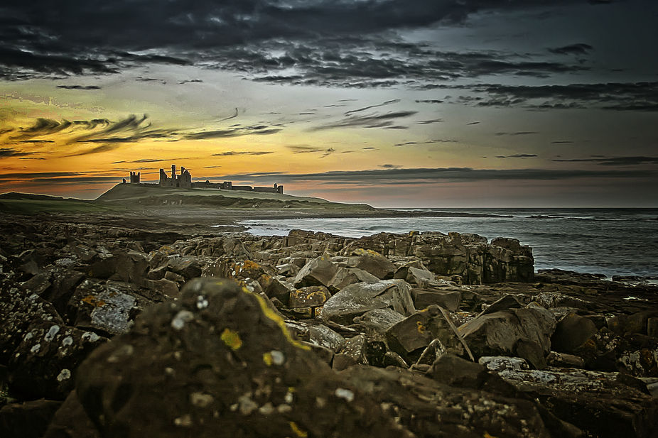 Time stands still as the sun sets over the picturesque ruins, that is Dunstanburgh Castle.