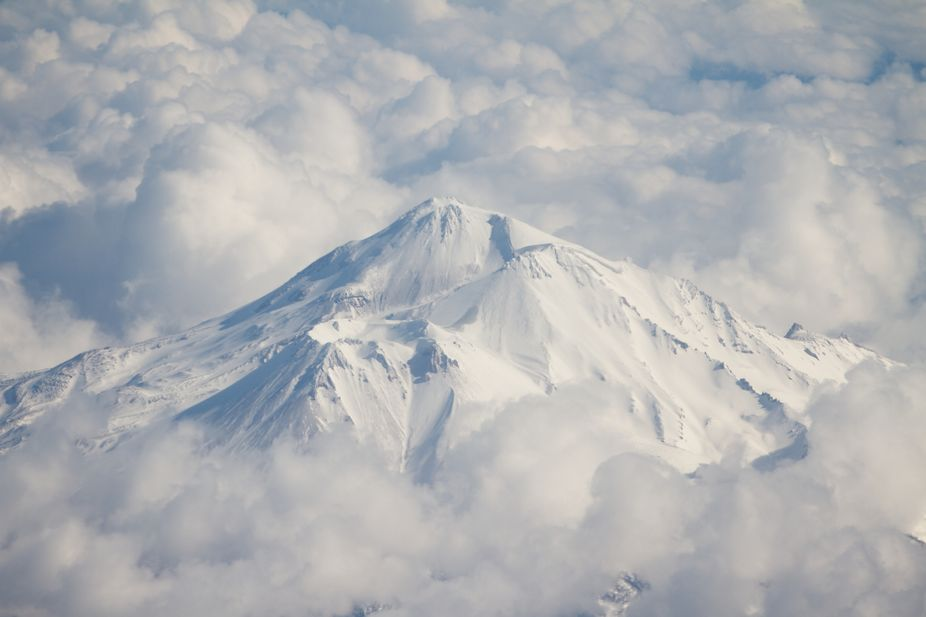 Flying over Mt. Shasta made my heart skip a beat.  It made me feel serene taking this photo and s...
