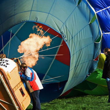 A ballooning team inflating their hot air balloon.