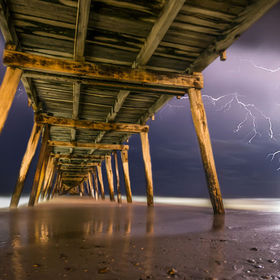 Mother Nature shows her fury as I take cover under the pier to capture her flexing her power!