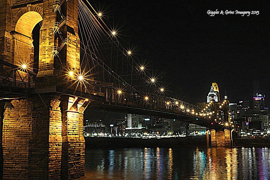 The John A. Roebling Suspension Bridge spans the Ohio River between Cincinnati, Ohio and Covingto...