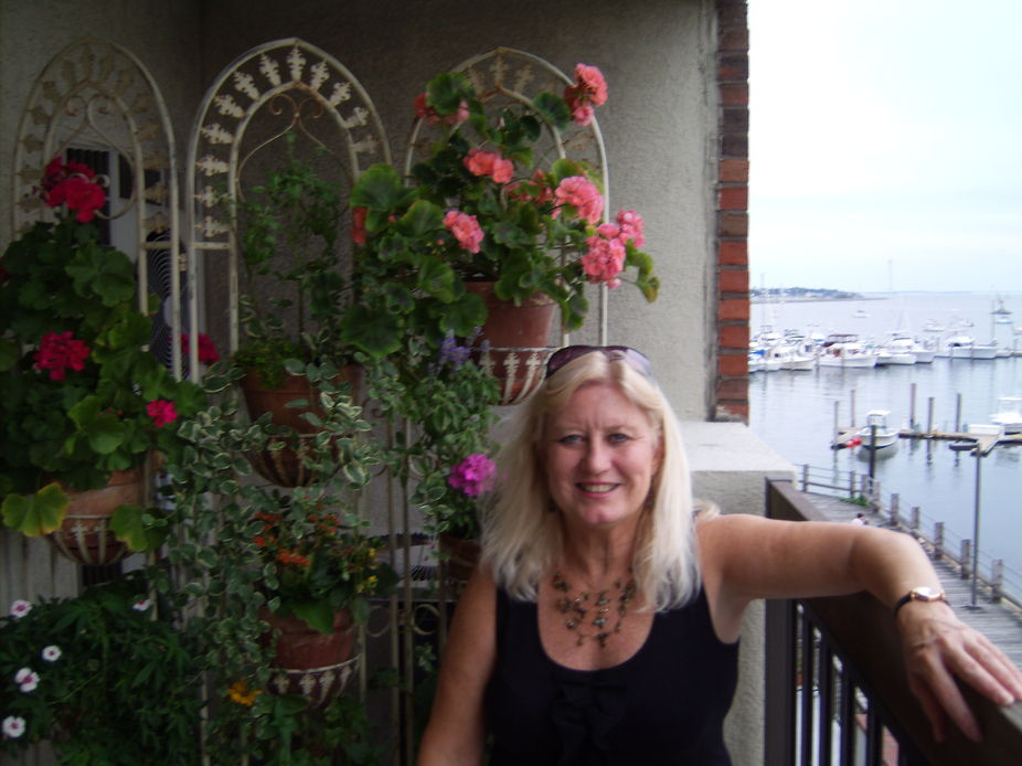 Me, flowers on balcony