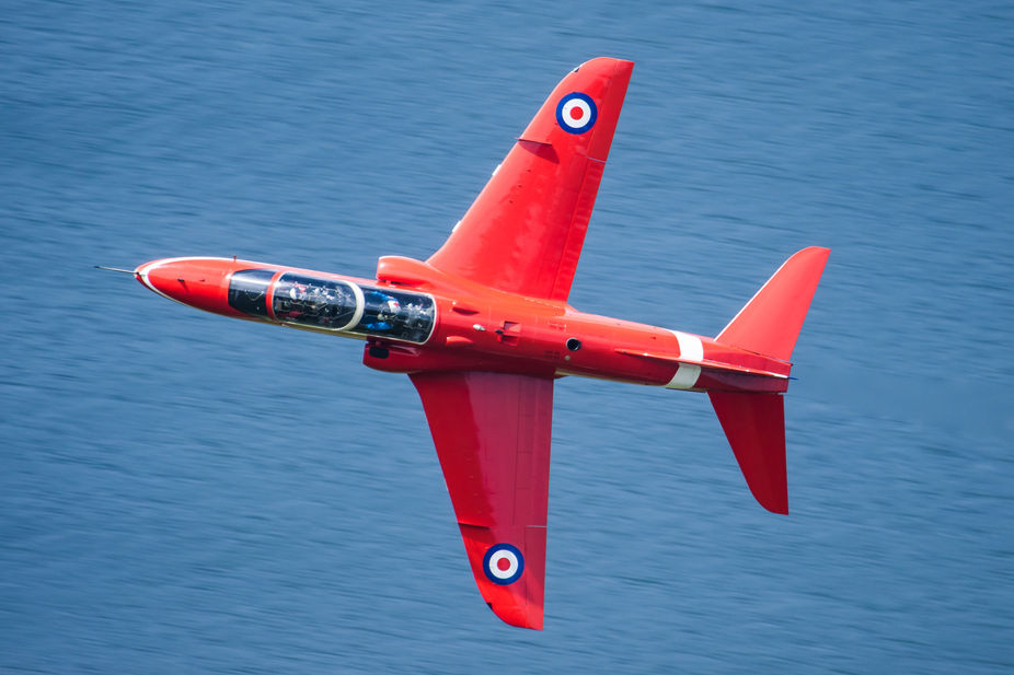 A Royal Air Force Aerobatic Team Red Arrow on a low level sortie in the Mach Loop, North Wales.