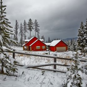 Red house and barn in winter snow