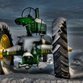 Restored JD Tractor in the snow
