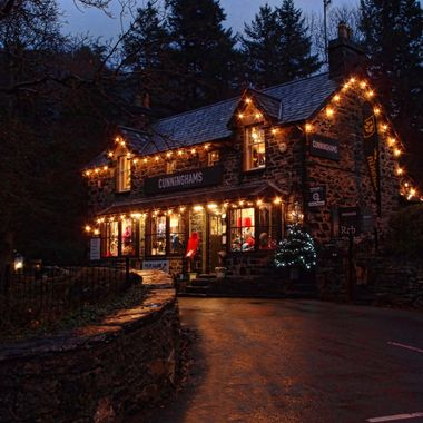 Betws y Coed in Snowdonia. one of the shops arrayed with lights.