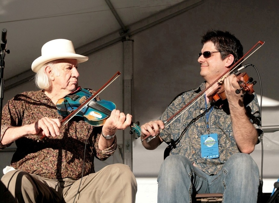 Two fiddle players facing each other.  Reality is that there were 3 people between these two.