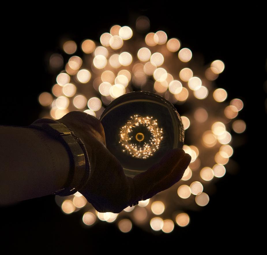 a Christmas light wreath seen inside my crystal ball