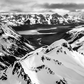 Beautiful view of Alaska's gorgeous mountains (in B&W), from a plane, overlooking Adam's Inlet in southeastern Alaska.