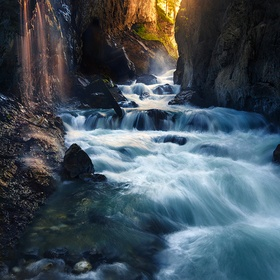 Late morning sun enters the top entrance of the Partnach gorge in the Bavarian Alps. The recent rains created a stunning display of side falls tu...