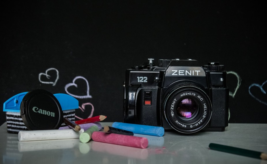 one zenith old film camera photographed infront of a black bord