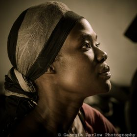 A side profile portrait of a student in class in Uganda.