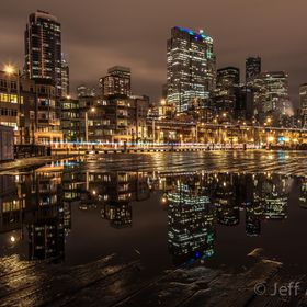 This shot of downtown Seattle comes from a pier on the waterfront after a rainstorm.