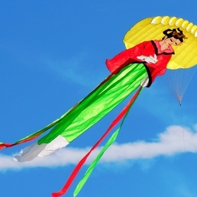 Geisha kite sports a yellow parasol in Sand Key Park, Florida