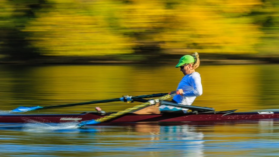 Panning shot of a female rower at the 2013 Head of the Charles Regatta in Cambridge, MA, USA