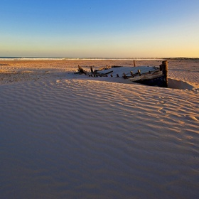An abandoned fishing boat - once the proud possession and provider of food, now left to rott back to nature. The Glory May lies on the beach near...