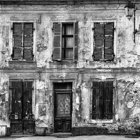 A mono image of a derelict house from front elevation.