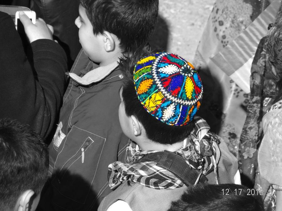 Kurdish Traditional cap on a boy head at Flag festival at Erbil Citadel.