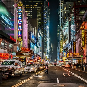 Times Square at night.  Full of life , lights, colors & Architecture.