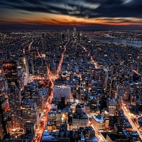 Broadway, the 5th and the 6th Avenue (Avenue of the Americas) illuminated, like the arteries of a giant living being, and shot from the top of th...