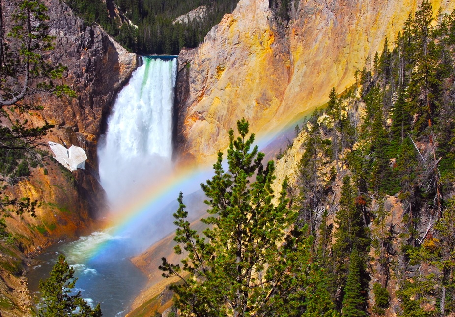 On sunny mornings such as this one, around 9:30am the sunlight shines into Yellowstone Canyon at ...