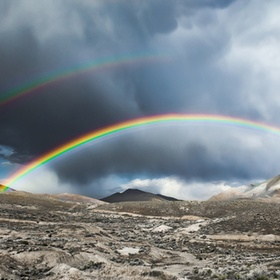Double Rainbow in the High Deserts of Nevada. Its a pano stitch 7500pix  wide.