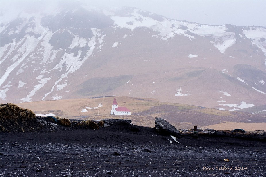 Vik church in Iceland  from the beach