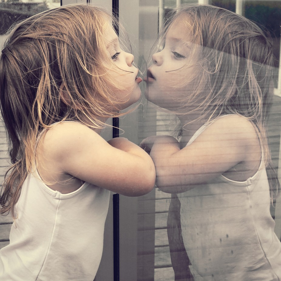 Reflection by Child_Expressions - The Face in the Mirror Photo Contest