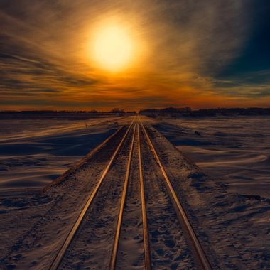 The setting sun glows upon the frozen steel in this frozen wonderland. Journey to Sunset 036614