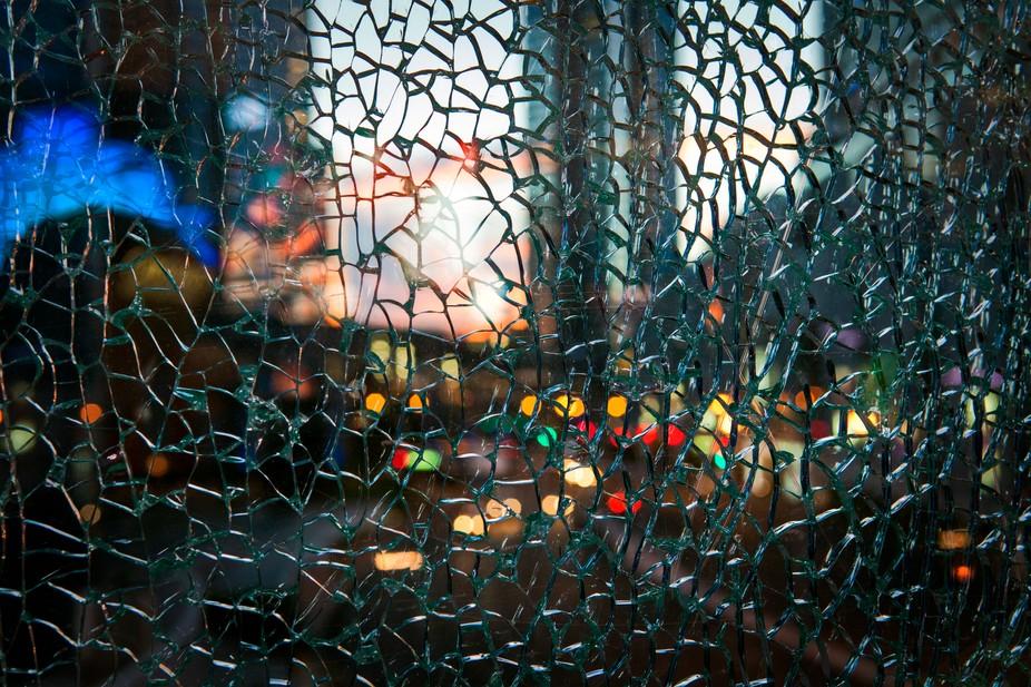 Vegas lights behind broken glass