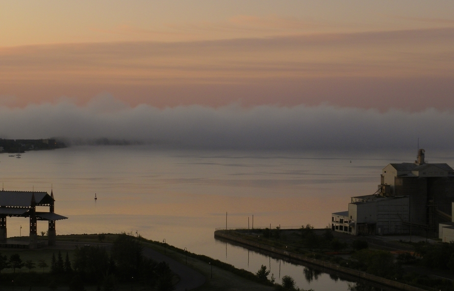 Fog rolls across the St. Louis Bay behind an abandoned shipping grain elevator in Duluth, MN.