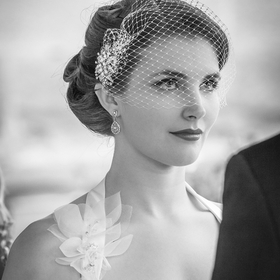 A close up of a bride looking intensely into her grooms eyes.