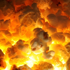 Popcorn lit from underneath to give hot look