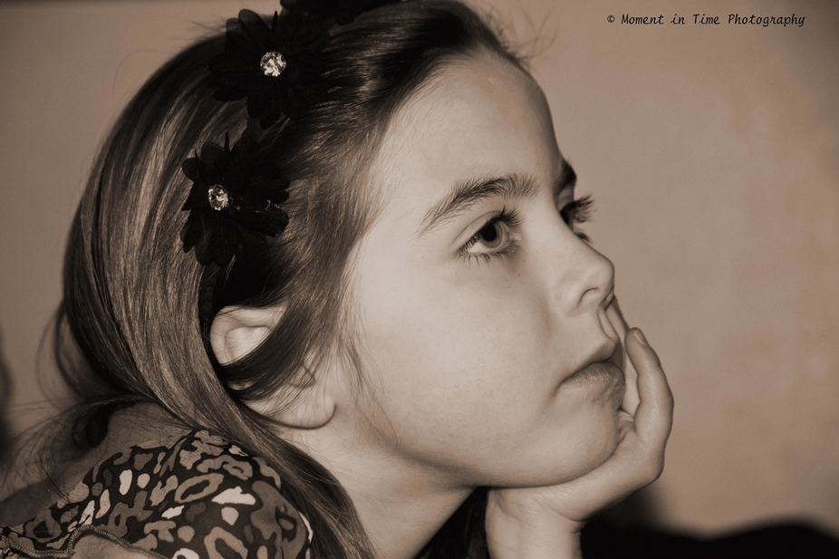 My beautiful granddaughter in deep thought