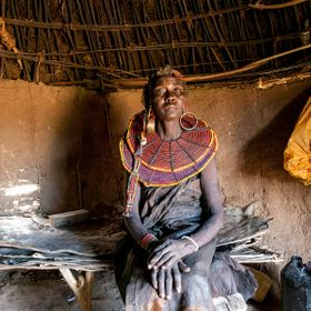 An elder of the Pokot tribe in Kenya sits in her hut.