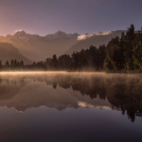 Sun beams down Lake Matheson
