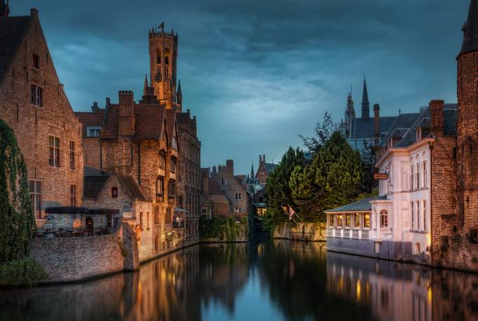 Belgium - Canal in the Middle age town by jacobsurland
