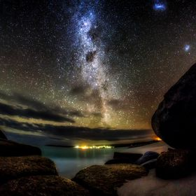 The arm of the Milky Way, overlooking Binalong Bay on the Tasmanian East Coast.